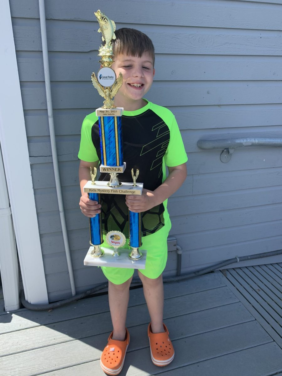 Palmer with his winning trophy at the Kids' Mystery Fish Challenge on May 31, 2021.