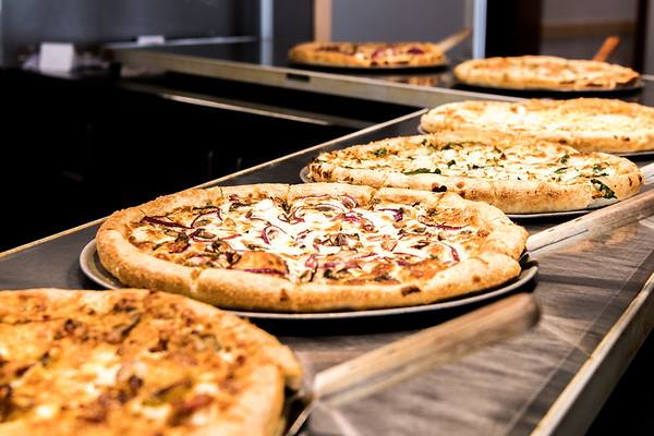 Buffet line-up of six pizzas at Aver's Pizza.
