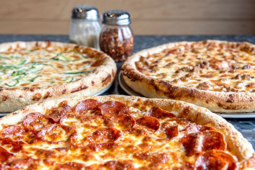 Three delicious pizzas from Aver's Pizza.