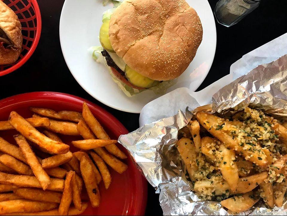 Burger, fries, and wedge potatoes at CheeseSteak Restaurant Elk Grove