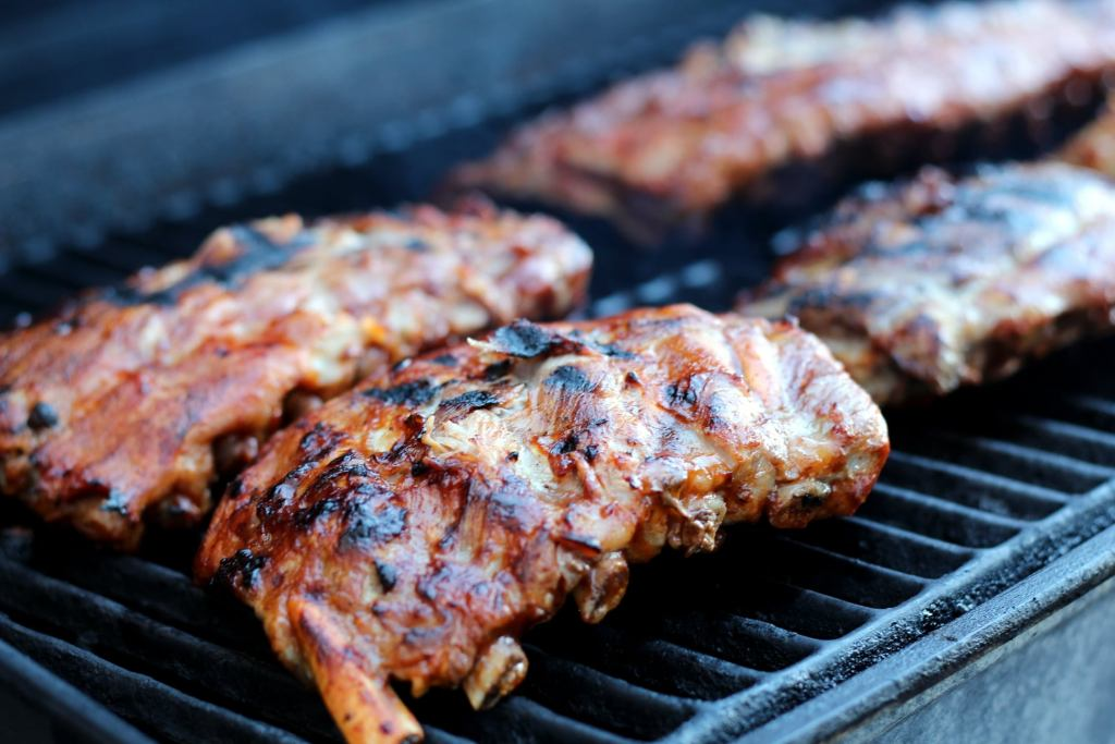 Baby back ribs on a mesquite wood grill at The Horseshoe Grill