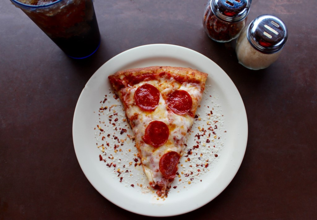 Delicious slice of pepperoni pizza on a plate at a Cicis Pizza fundraising event
