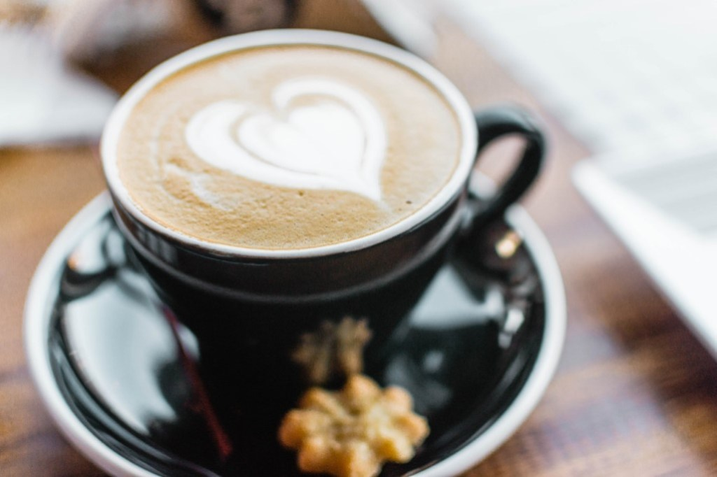Coffee with heart drawn with cream foam at fundraising restaurants