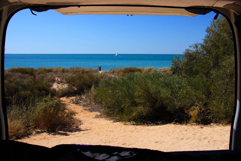 Backpackers view of Australian beach from van