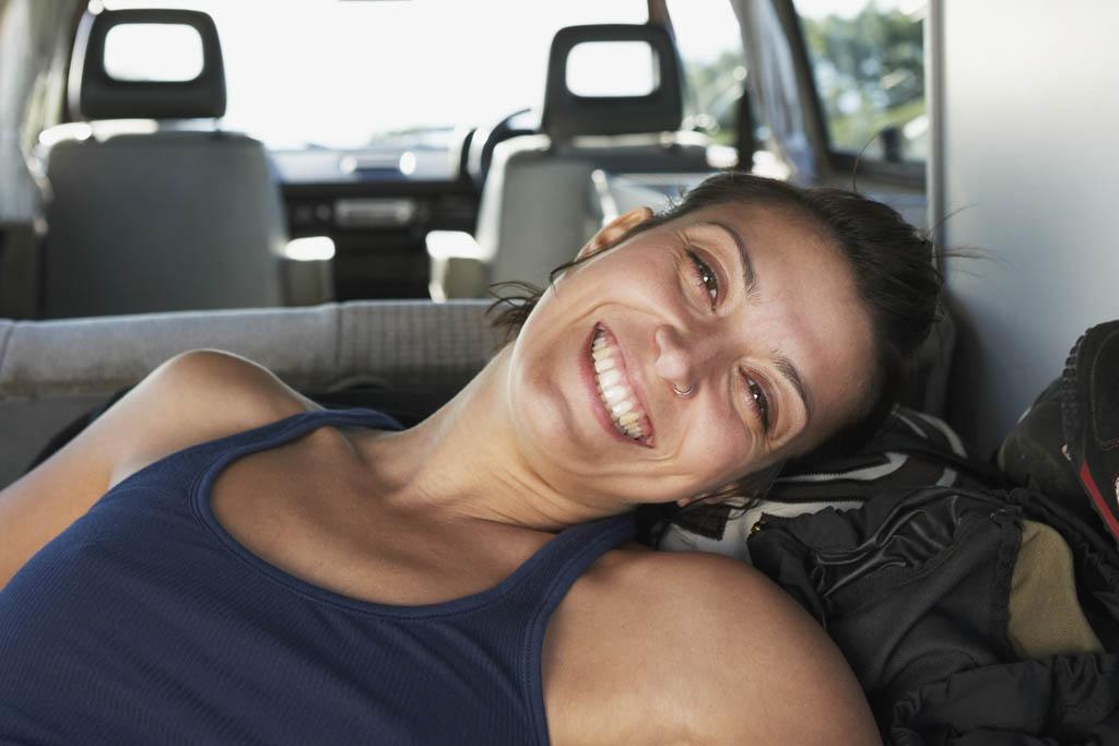 Happy backpacker in campervan