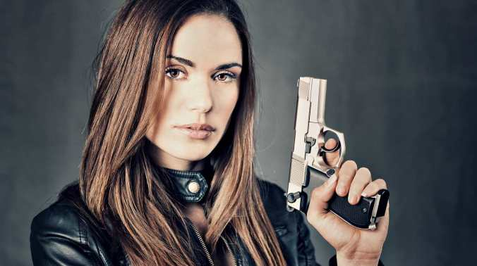 Image result for woman defending herself with gun
