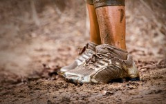 View of muddy runner shoes, standing in the mud