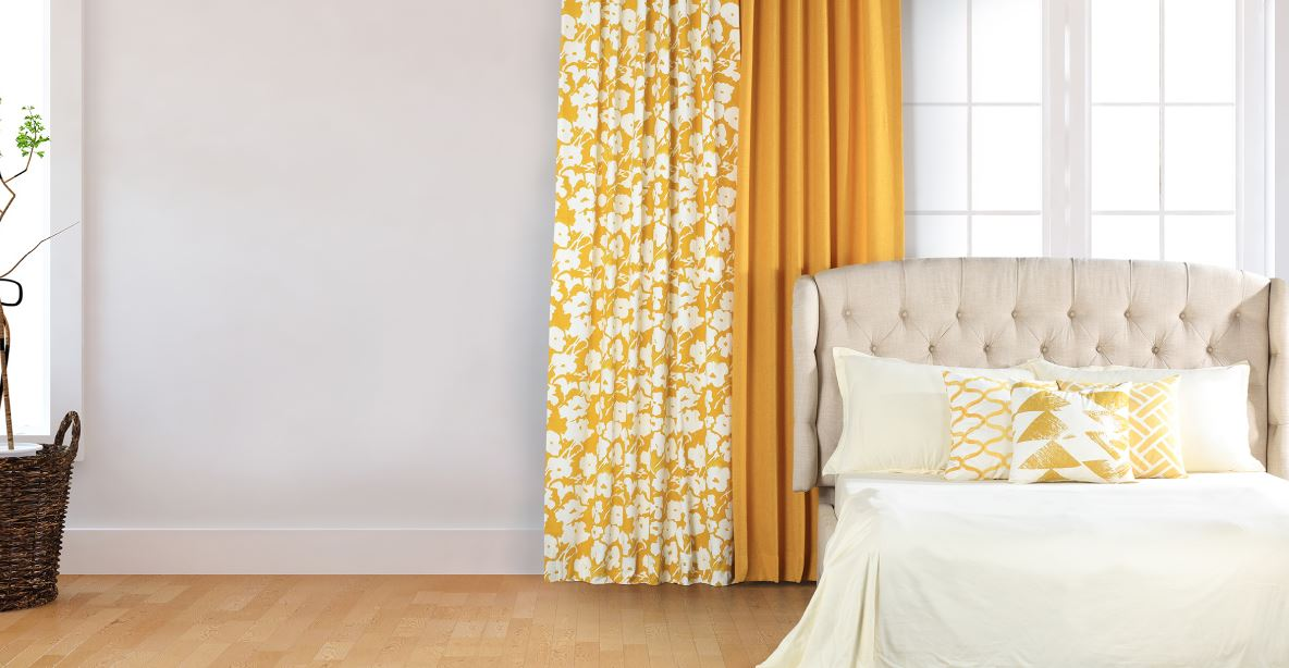 yellow cotton curtains hanging in bedroom
