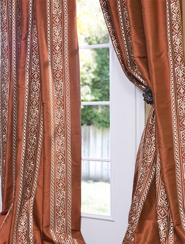 Add a fun eclectic element to your home with mismatched drapery panels