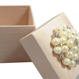 Dupioni silk favor box with large pearl brooch
