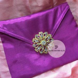 Crystal brooch embellished silk wedding envelope