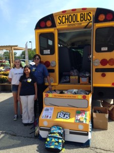 Volunteer Madeleine Larsen and Mt. Prospect Walmart Assistant Manager Christopher Shoun and an employee volunteer on August 9th at the Fill the Bus event.