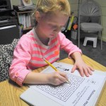 Slanted paper and a 3-ring binder can facilitate a fluid handwriting style.