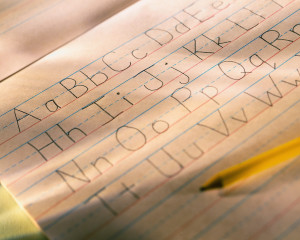 Alphabet Written on Notepad