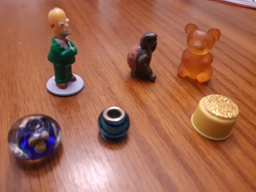 Board game pieces can be found at home or a discount store.