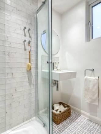 A beautiful grey shower room with Lattice by Dee Hardwicke in Pebble Grey