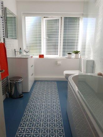 Ravi's bathroom in Lattice Cornflower Blue by Dee Hardwicke & Little Bricks Forget-me-Not (Fitted by Paul's Floors)