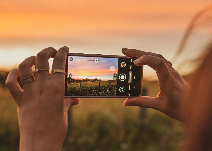 Woman taking photo using phone