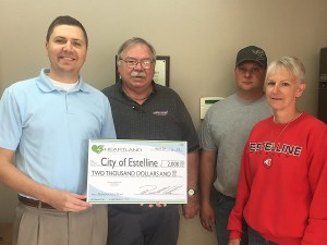 From left to right: Heartland Director of Economic Development Ryan Brown presents a grant to Estelline Rodeo Club members DanDeWitt, Lance Mennenga and Donna Thompson.