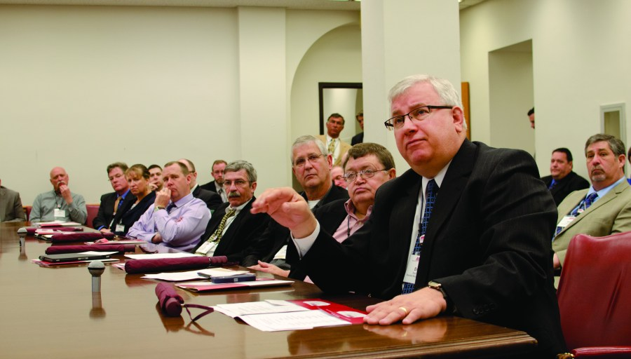 Brad Roos, foreground, discussed concerns in regards to third-party electric sales during visits with legislative leaders at the Minnesota State Capitol during the MMUA Legislative Conference. Photo courtesy Steve Downer, MMUA.