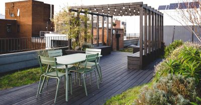 A rooftop terrace with panelled floor and wooden veranda