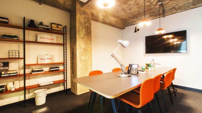 meeting room with orange chairs around