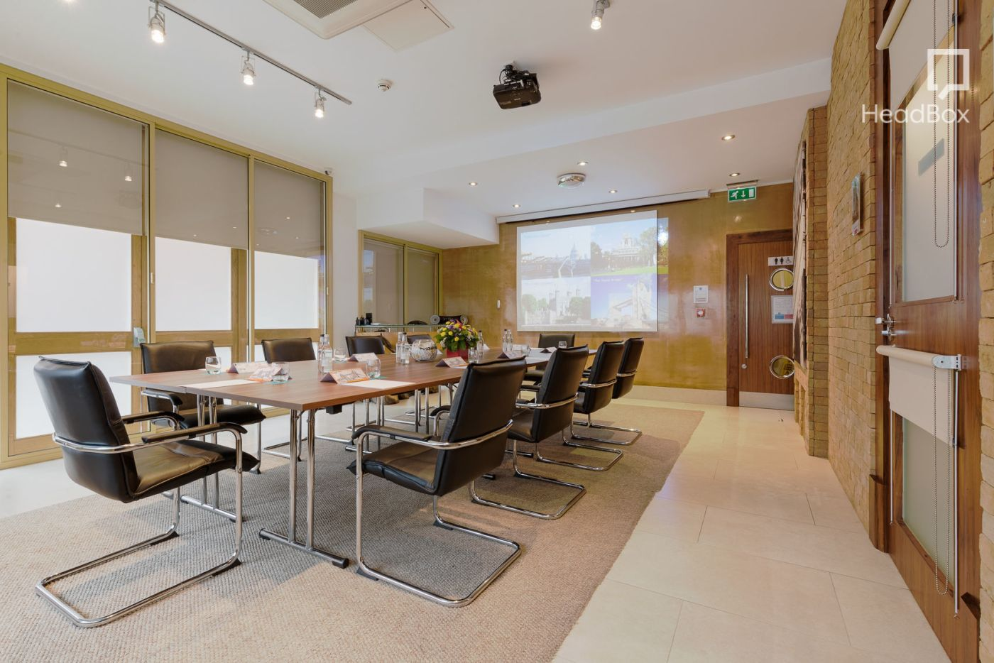 A large meeting room in Tower Hill with a projector on the back wall