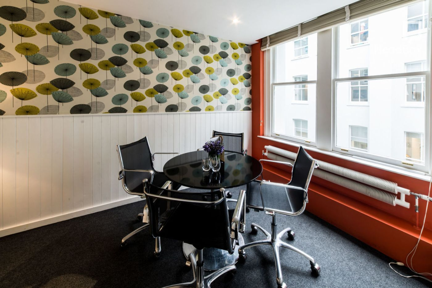 meeting room with coloured umbrella wall