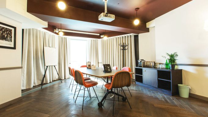 small meeting room with orange chairs