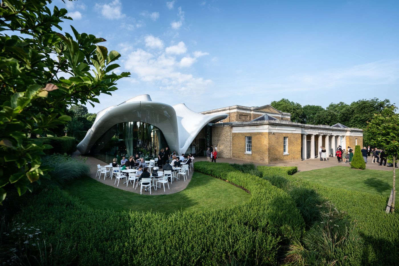 An unusual party venue London, Serpentine Sackler Gallery is a unique and contemporary Space in Kensington Gardens. The right hand side of the building is a traditional square, brick building whilst the left hand side is a creative structure that's white and curved.
