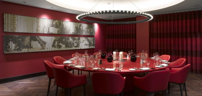 red dining room with mosaic art