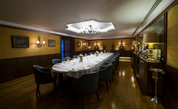 dimly lit private dining rooms, Corrigan Mayfair