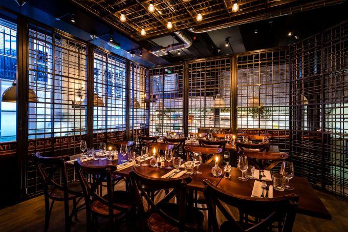 Dim lit cage designed dining room