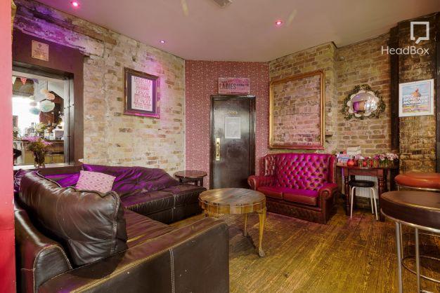 exposed brick room with purple lighting