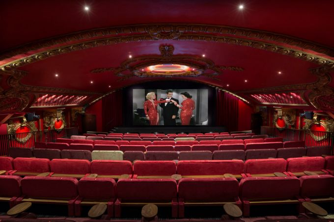 Large cinema showing an old film