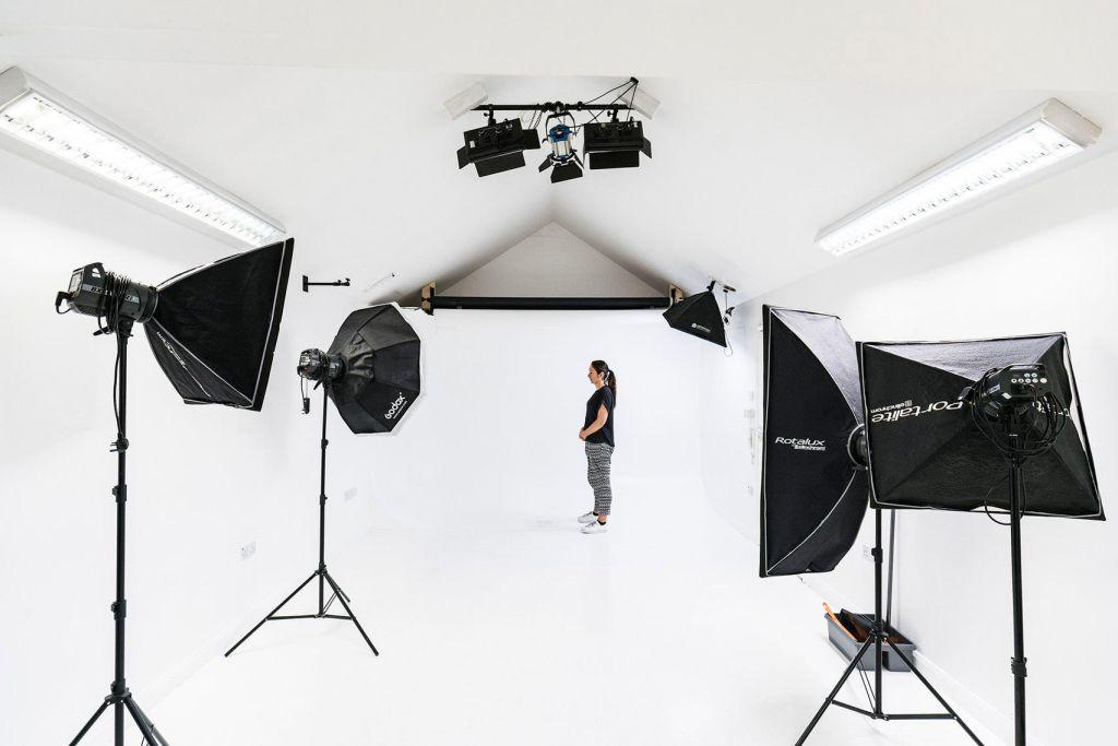 large white studio with black equipment