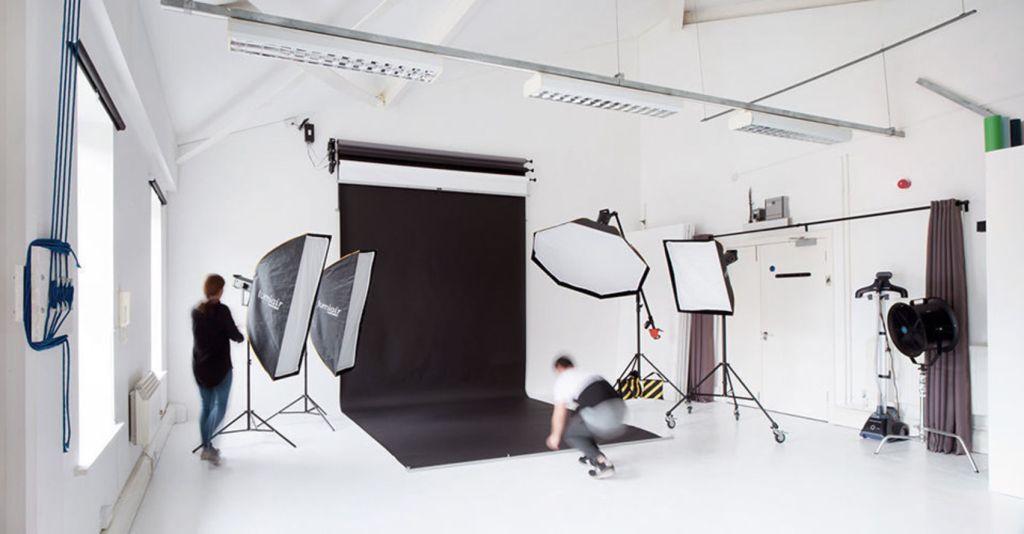 White studio with a black backdrop