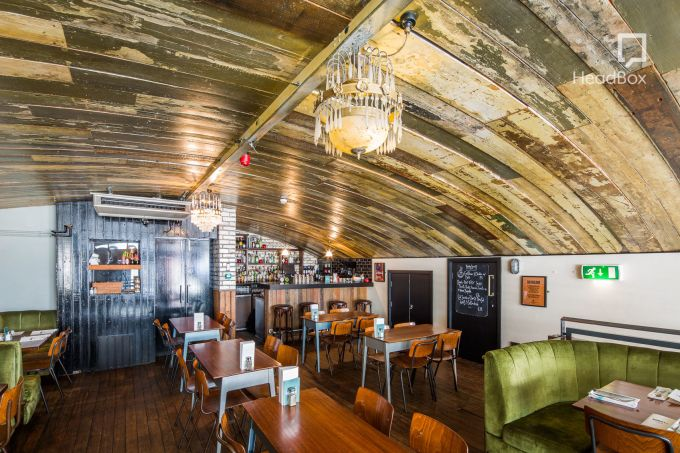 space with a curved wooden ceiling
