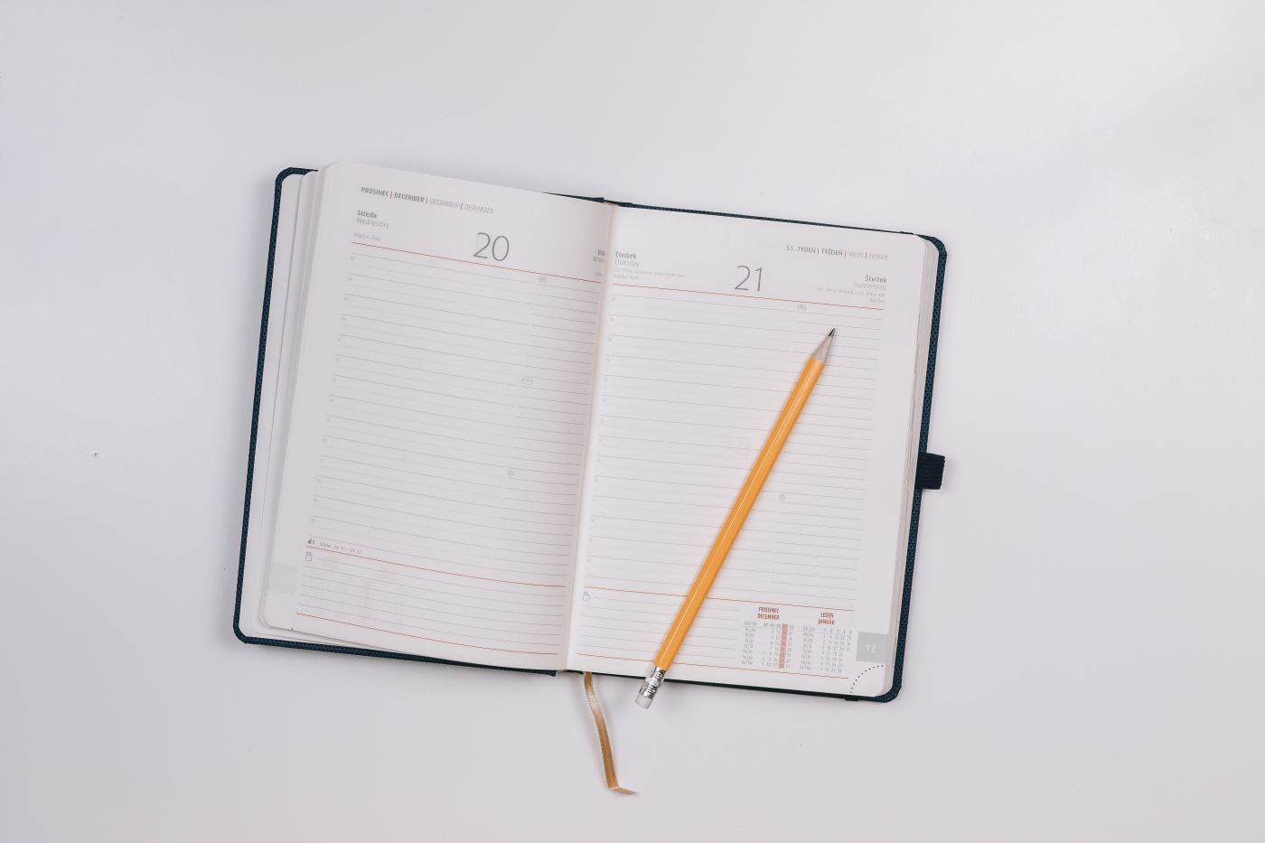 A5 diary opened with pencil