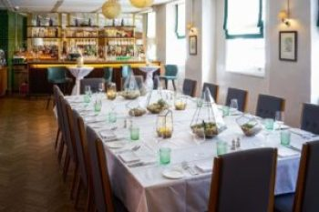 private dining room with private bar, natural light and art on the walls