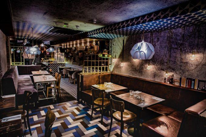 dark restaurants with quirky tiled floor