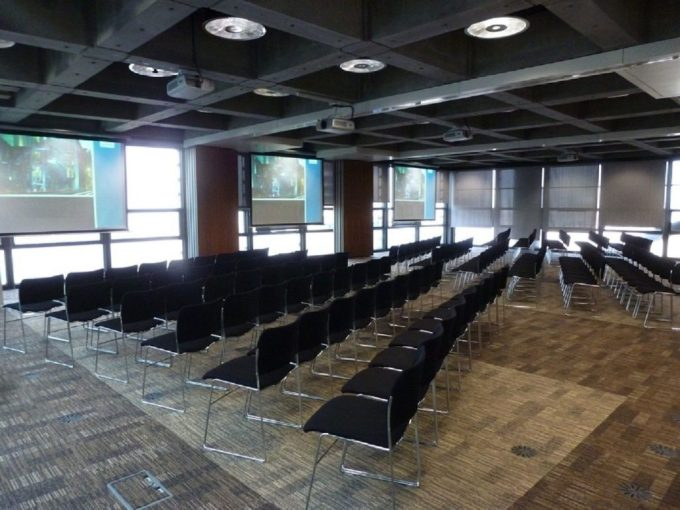 room with rows of black chairs