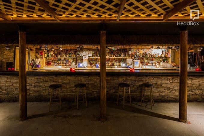 tiki-inspired bar made of bricks