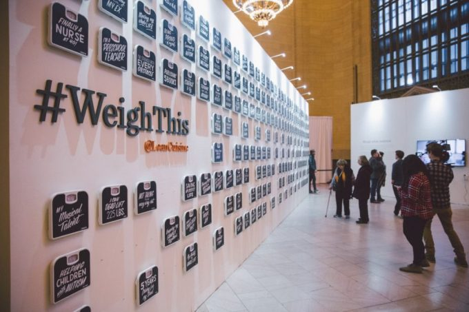 large wall that reads '#WeighThis'