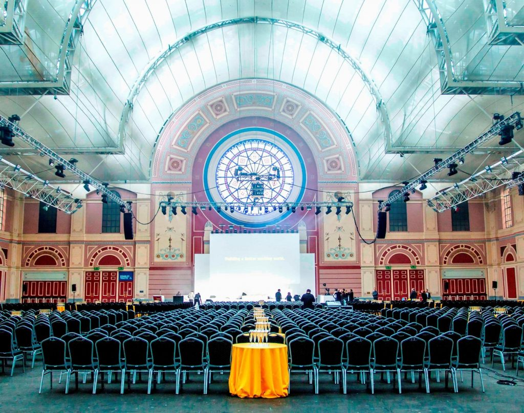 Alexandra Palace is a large grand building with high ceilings and Stained glass windows