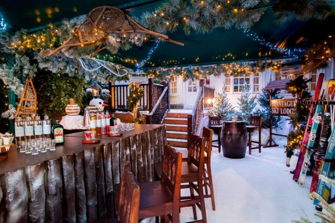 A ski lodge which transports you the mountains. Covered in snow and pine trees.