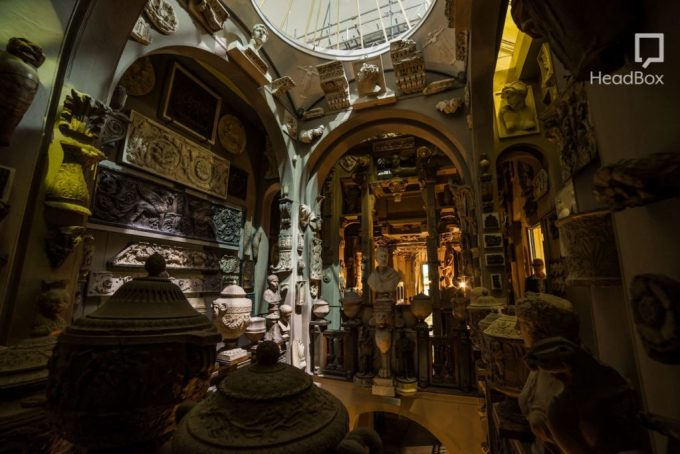 Historic museum with ceramic statues and archways