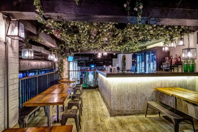 small bar tables and ceiling vines