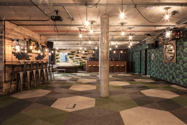 An open event Space with unique lighting. The Space is un-furnished with a bar on the left hand side. Great for venue hire London