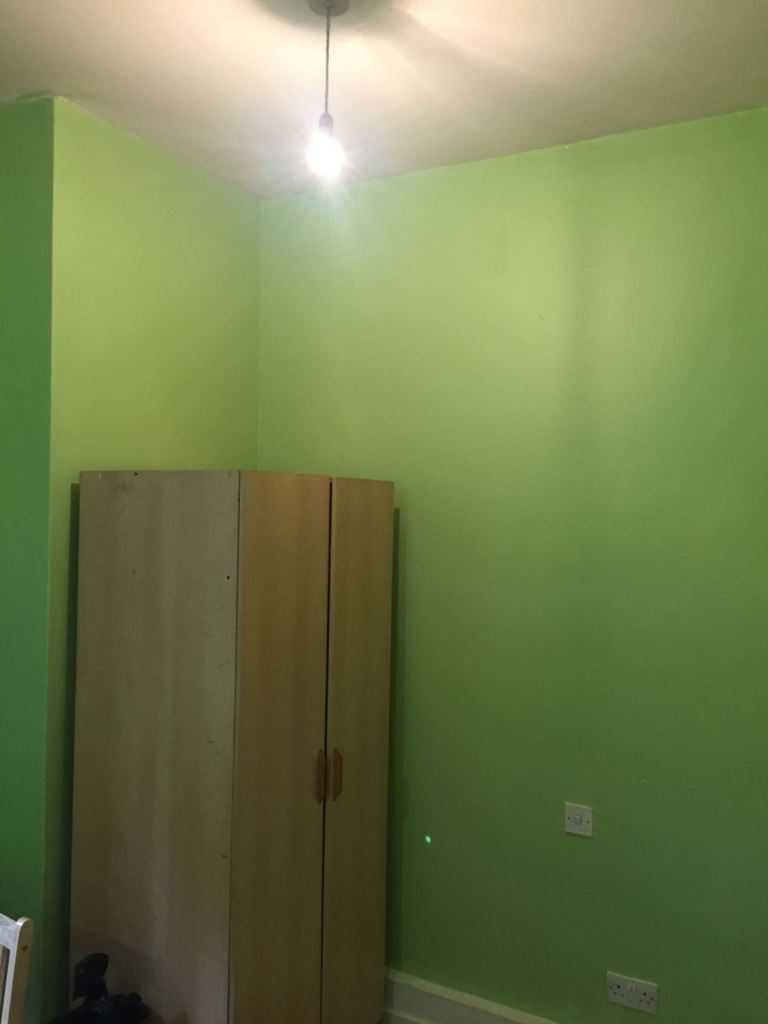 a large room with lime green walls